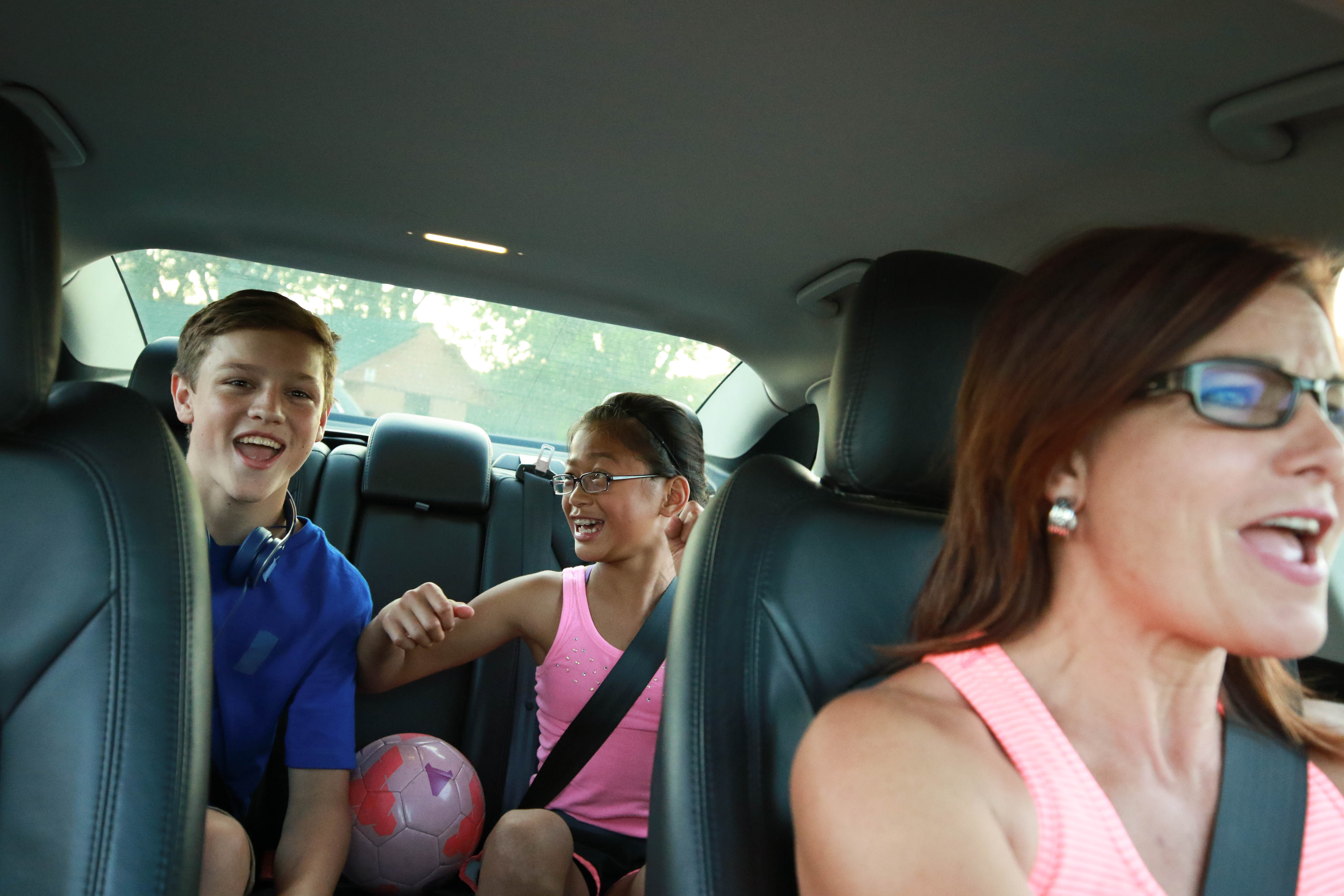 Mom with kids in car carpooling
