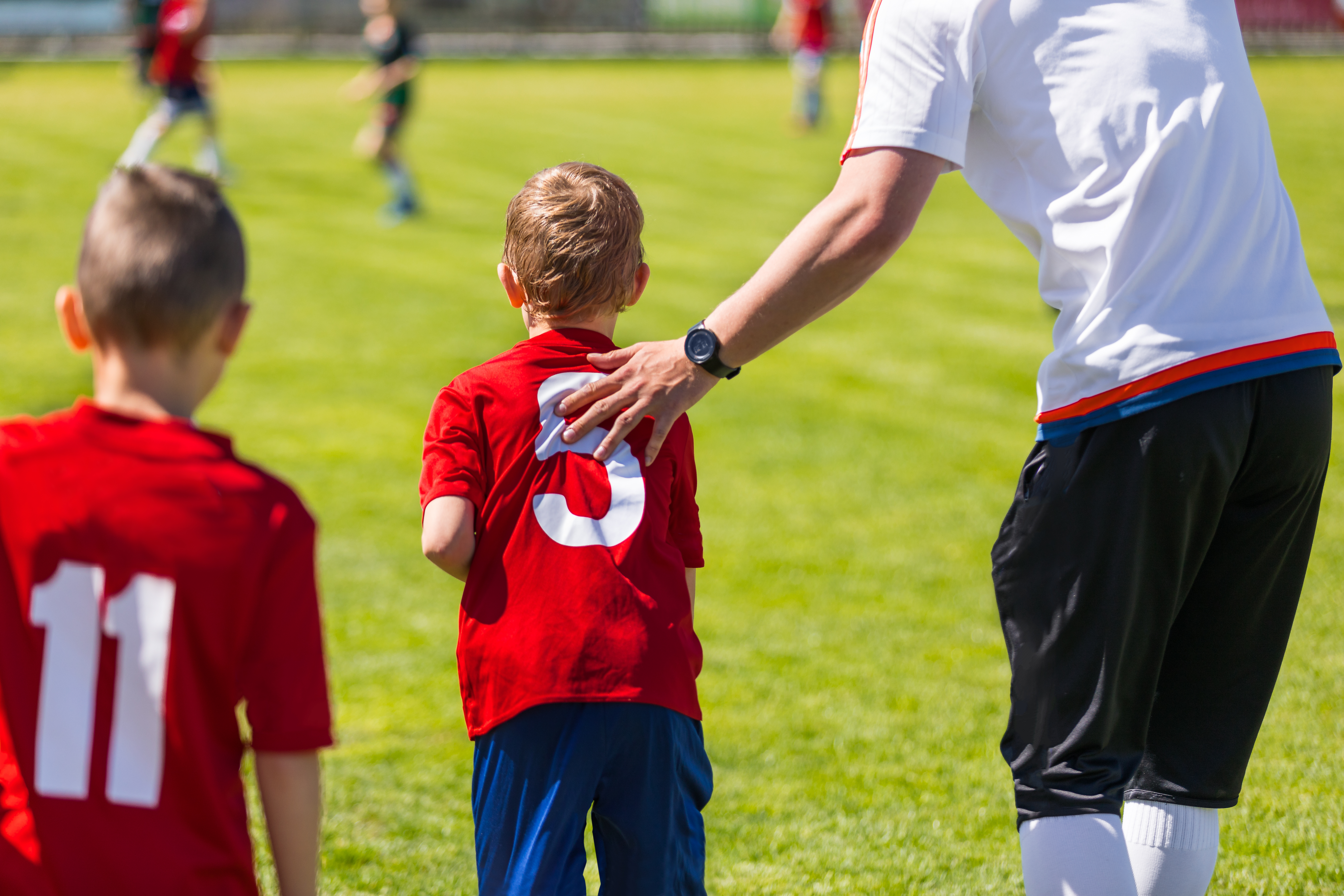 Article- 2 soccer players and coach
