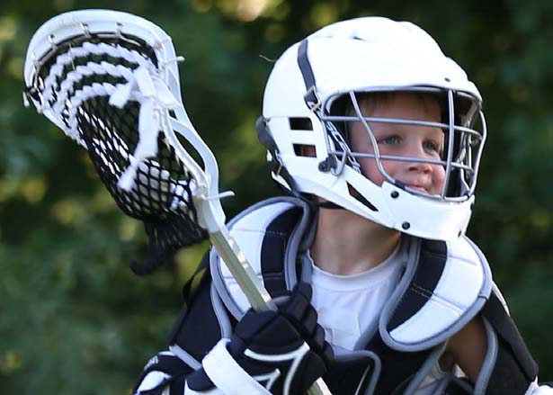 Young boy playing lacrosse