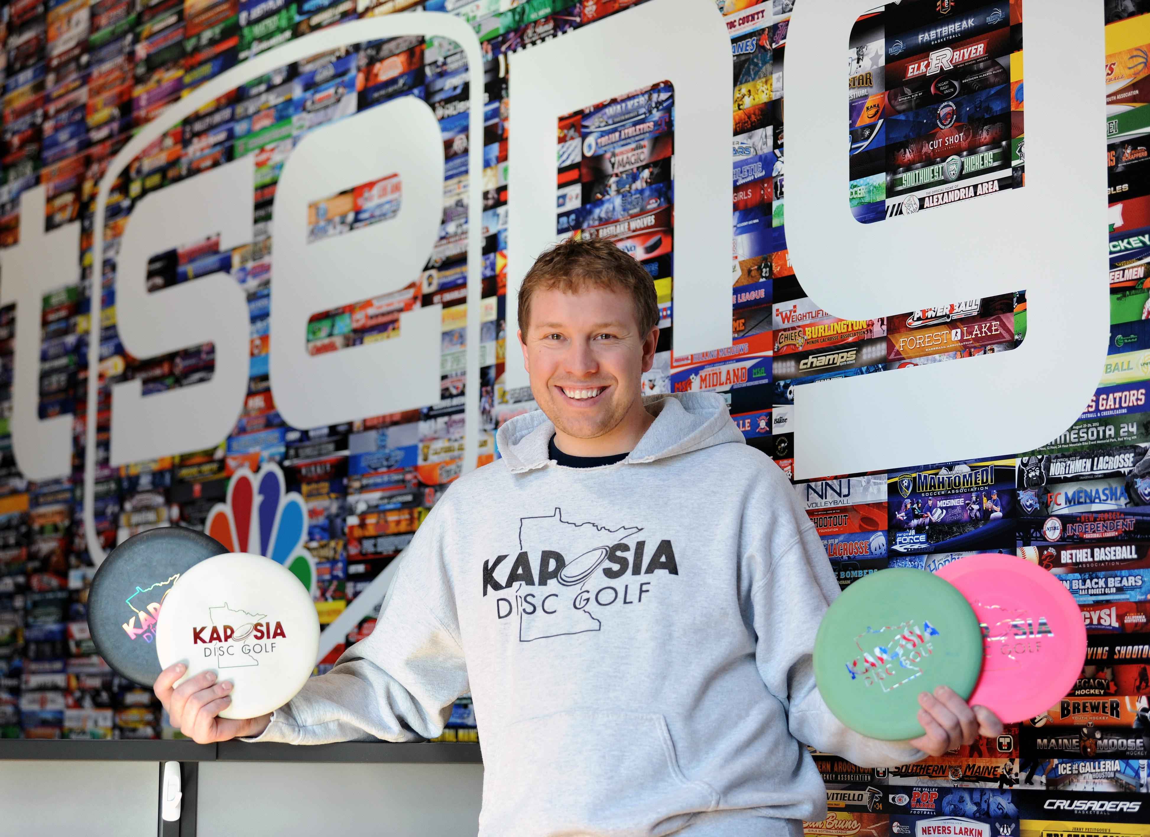 Phil Loprinzi with discs for disc golf