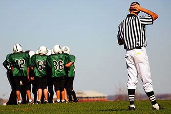 Football players and referee