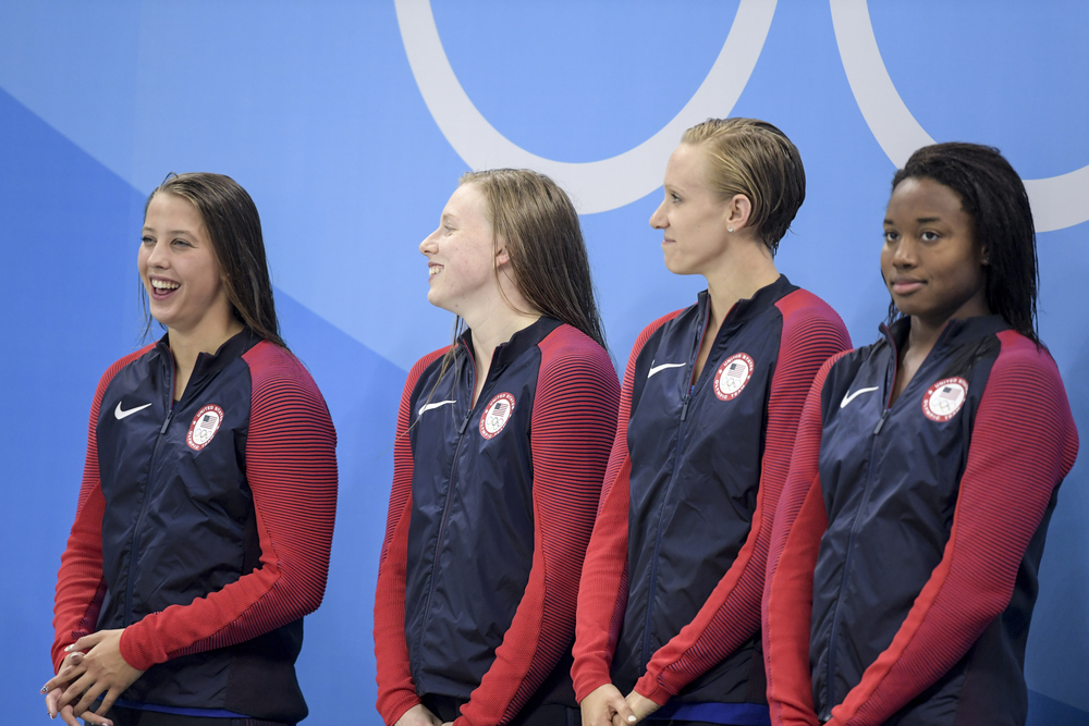 Gold medalist Kathleen Baker, Lilly King, Dana Vollmer and Simone Manuel (USA) during Women's 4 Ã? 100m medley relay of the Rio 2016 Olympics Games